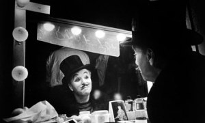 Charlie Chaplin looking into mirror
